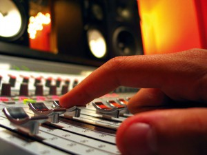 Photo of a person working at a mixing board