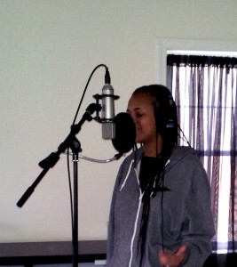 Kayla recording vocals in the studio