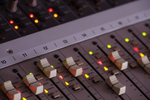 Close up of faders on a mixing board console