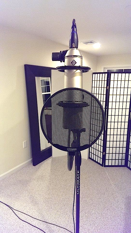 Cose up photo of a U87 vocal mic at Beach House Studios
