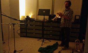 Chris Barrett recording trumpet at Beach House Studios in candlelight